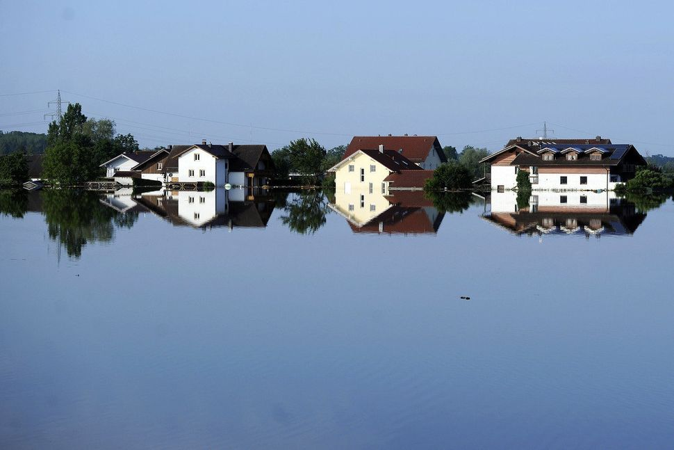 Buildings are reflected in the floodwater of the river Danube in Deggendorf, southern Germany, Friday, June 7, 2013. Heavy ra