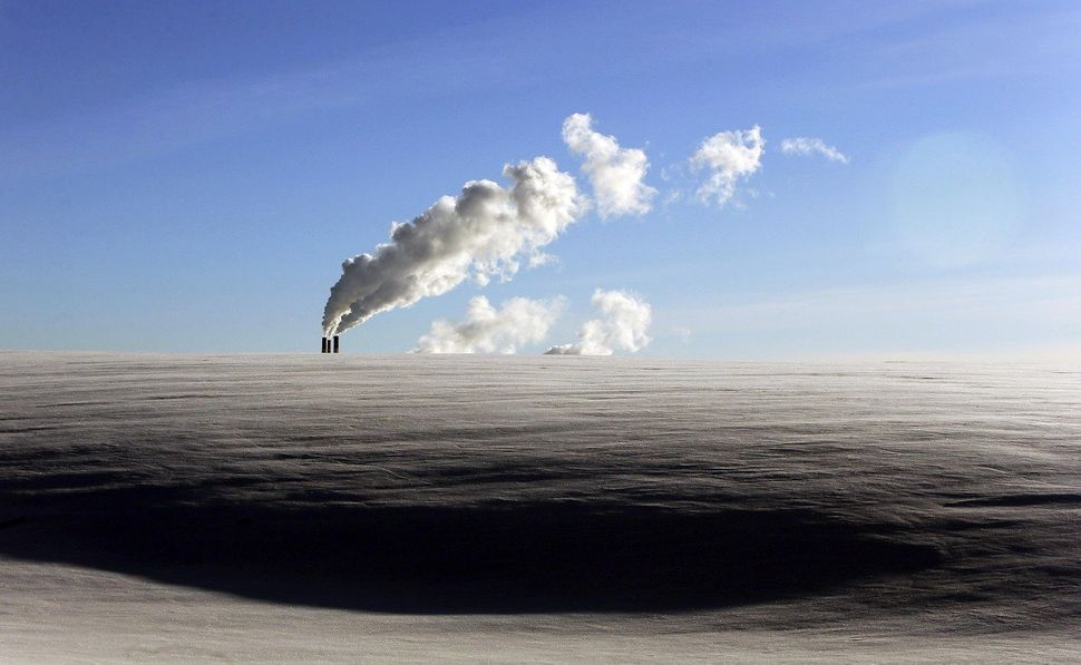Steam from a heating plant rises as at temperatures of -14 degrees Celsius (-6.8 degrees Fahrenheit) are recorded in Minsk, B