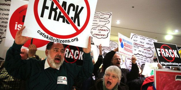 ALBANY, NY - JANUARY 08:  Anti-fracking protesters gather outside of the auditorium before New York Gov. Andrew Cuomo gives h
