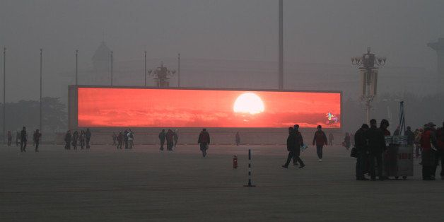 BEIJING, CHINA - JANUARY 16:  (CHINA OUT) The LED screen shows the rising sun on the Tiananmen Square which is shrouded with
