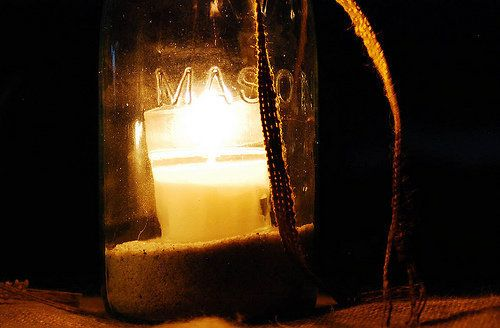 If you want to light candles outside, do it in a jar. Make sure you use a heat-tested glass that can handle the warmth (candl