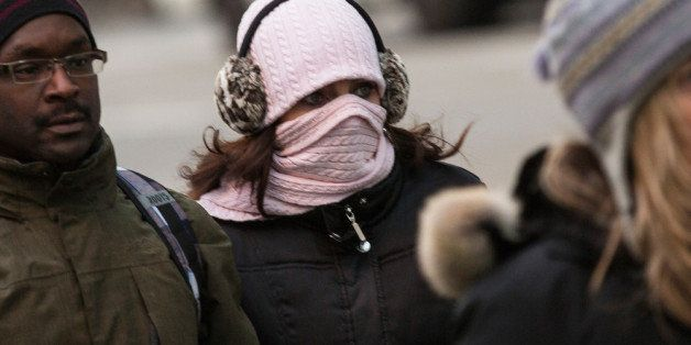 NEW YORK, NY - JANUARY 08:  A woman bundles up against the cold on the afternoon of January 8, 2014 in New York City.  Today
