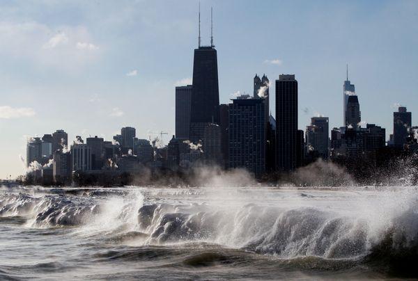 Ice forms as waves crash along the Lake Michigan shore Monday, Jan. 27, 2014. (AP Photo/Kiichiro Sato)
