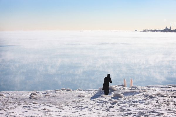 With temperatures hovering around -10 degrees steam rises from Lake Michigan January 27, 2014. (Photo by Scott Olson/Getty Im