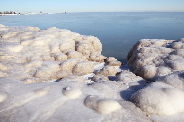 Ice forms along the shore of Lake Michigan as temperatures hovered around -10 degrees on January 28, 2014. (Photo by Scott Ol