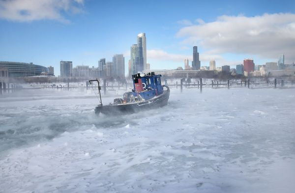 The tugboat Commissioner breaks up ice in Burnham Harbor near the Loop on January 21, 2014. (Photo by Scott Olson/Getty Image