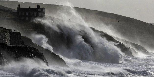 PORTHLEVEN, UNITED KINGDOM - FEBRUARY 08:  Storm waves break on February 8, 2014 at Porthleven in Cornwall, England. The UK i