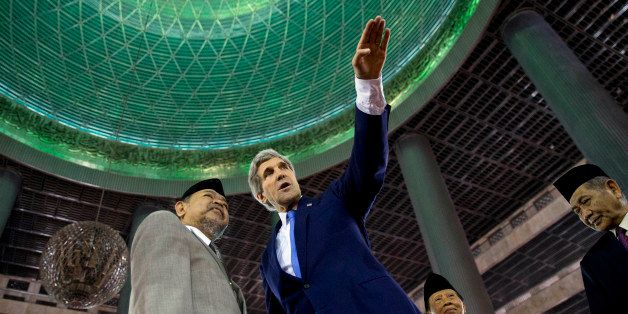 US Secretary of State John Kerry (R) tours the Istiqlal Mosque with Grand Imam K.H. Ali Mustafa Yaqub in Jakarta on February