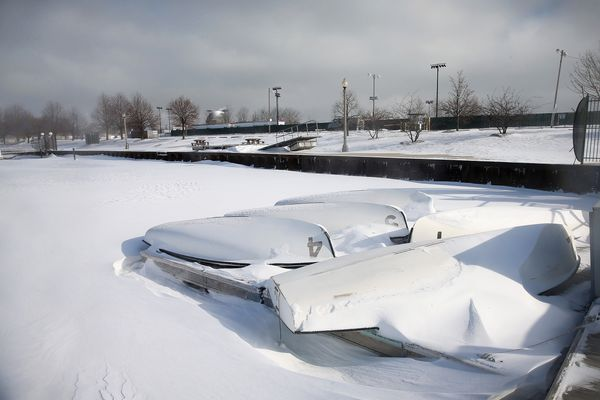 Boats sit snow-covered on a dock in Burnham Harbor near the Loop on January 21, 2014. (Photo by Scott Olson/Getty Images)
