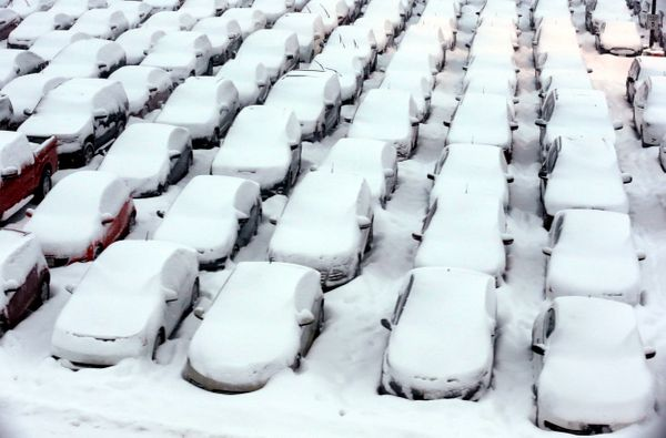 Cars are covered by snow in rental car parking lot at O'Hare International Airport in Chicago, Thursday, Jan. 2, 2014. (AP Ph