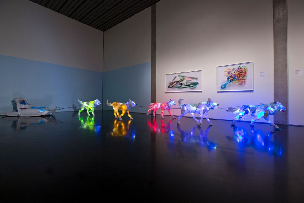 """Cynthia Minet, """"Sled Dogs,"""" post-consumer plastic and LEDs, 2013. Part of the """"Unsustainable Creatures"""" series. Minet is know"""