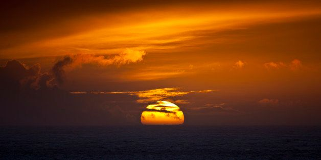 UNITED KINGDOM - FEBRUARY 07:  Sun setting in the west over the ocean at Woolacombe, North Devon, UK  (Photo by Tim Graham/Ge