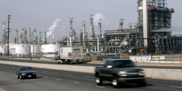 UNITED STATES - JANUARY 29:  Traffic passes by the Royal Dutch Shell Plc oil refinery in Wilmington, California, Monday, Jan.