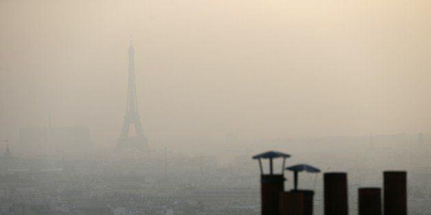 Photo taken on March 11, 2014 shows the Eiffel tower and Paris' roofs through a haze of pollution. French non-governmental or