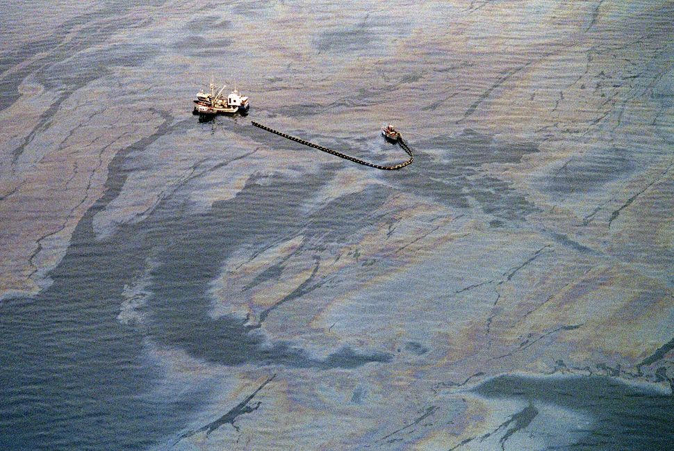 An oil skimming operation works in a heavy oil slick near Latouche Island in the southwest end of Prince William Sound on Apr