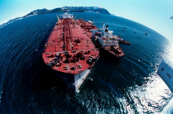 In this April 4, 1989 file photo, the grounded tanker Exxon Valdez, left, unloads oil onto a smaller tanker, San Francisco, a