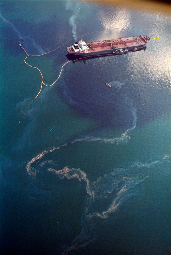 In this April 9, 1989 file photo, crude oil from the tanker Exxon Valdez, top, swirls on the surface of Alaska's Prince Willi