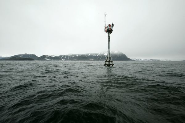 A pylon marks the location of the Exxon Valdez shipwreck on Bligh Reef on April 6, 2004 near Valdez, Alaska.  (Photo by David