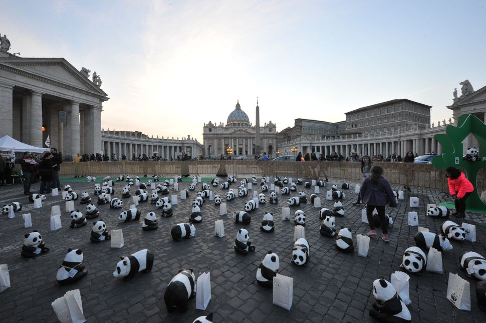 Activists of World Wide Fund (WWF) have set up pandas figures near St Peter's square as part of the Earth Hour campaign on Ma