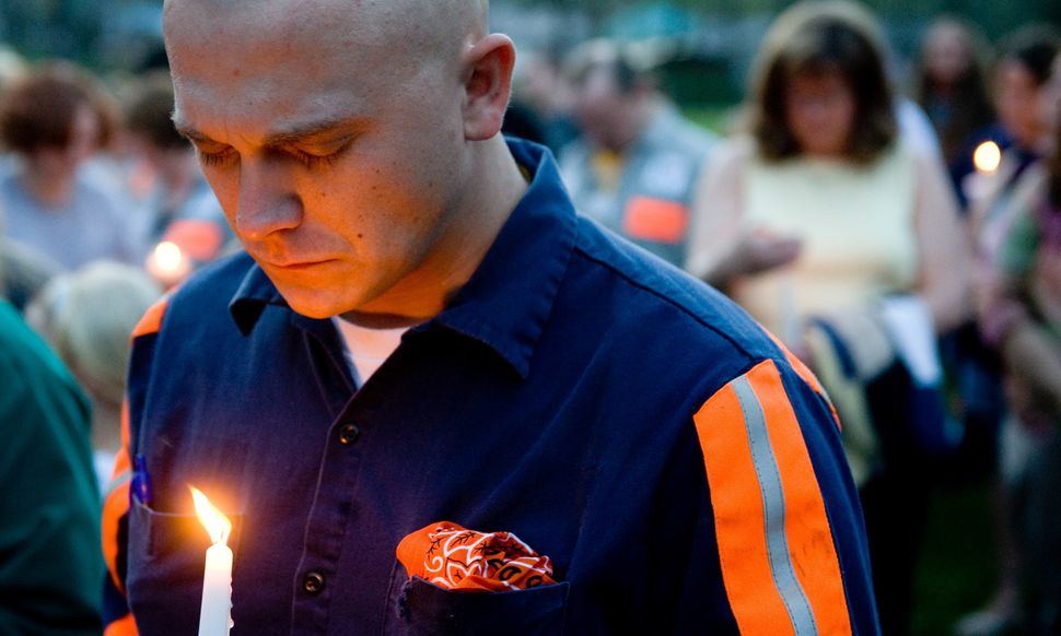 Thomas Jones, a local coal miner, participates in a candlelight vigil in Whitesville, West Virginia on April 7, 2010.  AFP PH