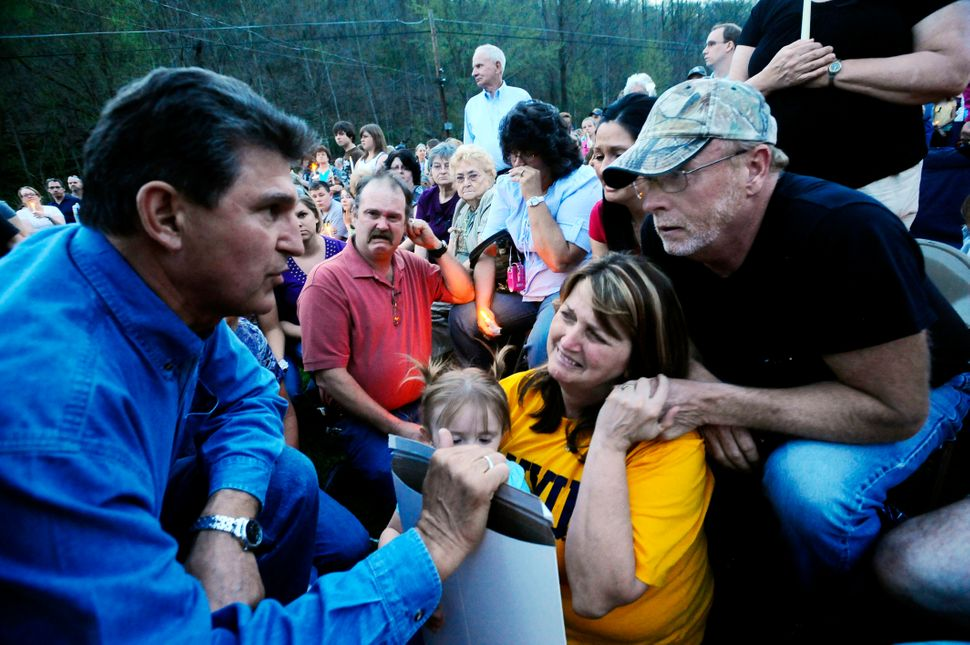 Gov. Joe Manchin, left, gives a state certificate to the family of deceased coal miner Josh Napper on Wednesday, April 7, 201
