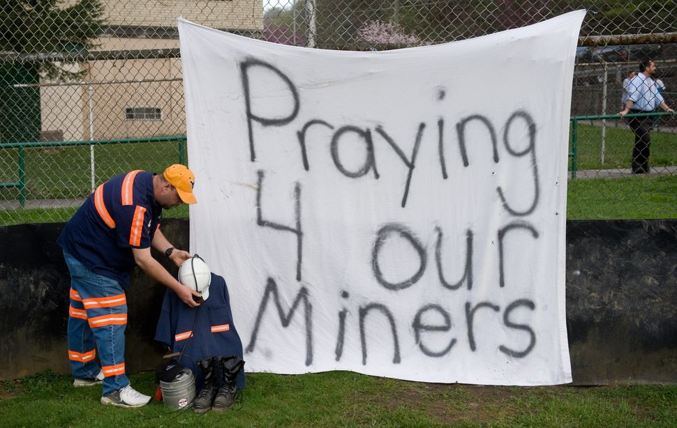 Terry Bailey of Naoma, W.Va., a coal miner at Progress Coal, sets up a memorial on April 7, 2010 for the miners that were kil