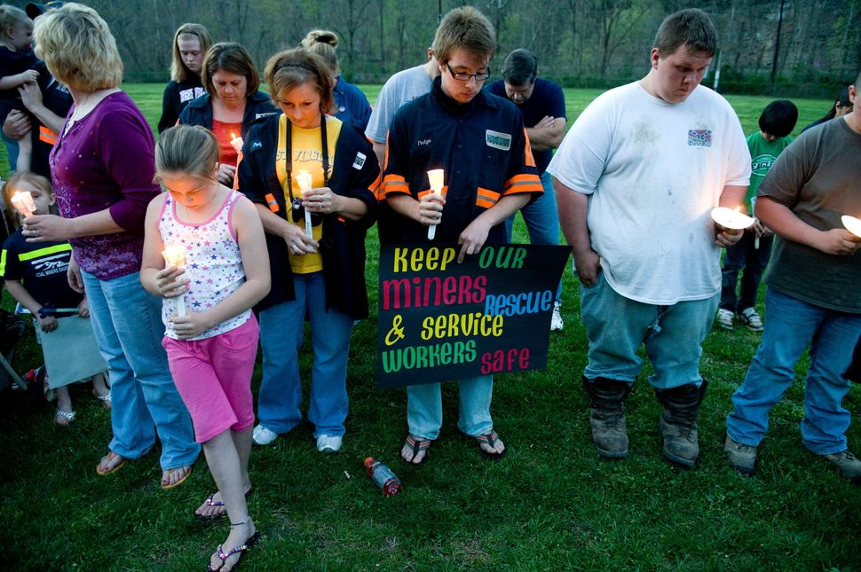 Members of the local community participate in a candlelight vigil in Whitesville, West Virginia on April 7, 2010. AFP PHOTO /
