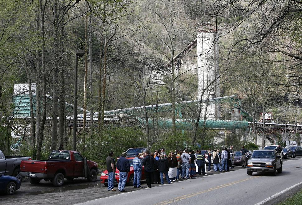Supporters of mine workers show their support at the entrance of the Upper Big Branch Coal Mine on April 9, 2010 in Montcoal,