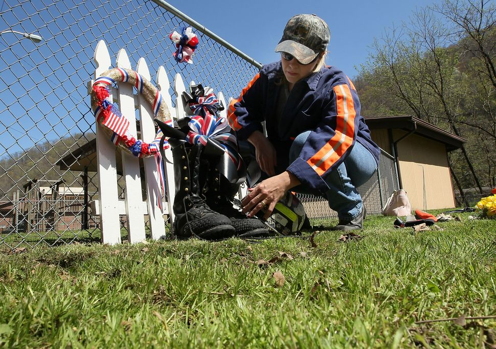 Jennie Bennett helps put together a small memorial on April 10, 2010 in Whitesville, West Virginia to honor the 29 miners kil
