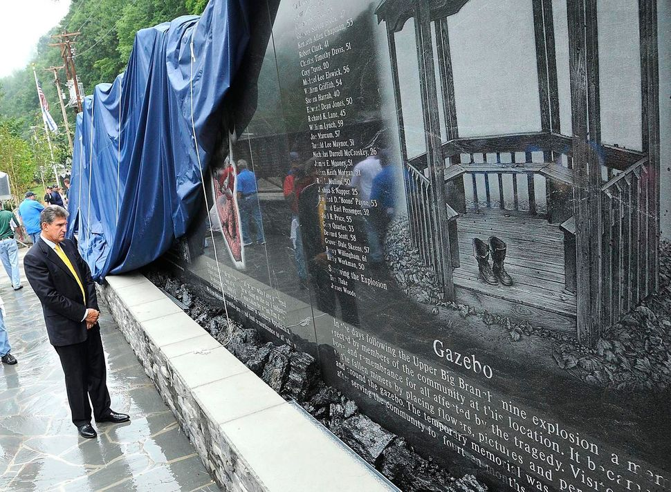 Sen. Joe Manchin looks over the 48-foot-long granite monument of the Upper Big Branch Miners, Friday, July 27, 2012 in Whites