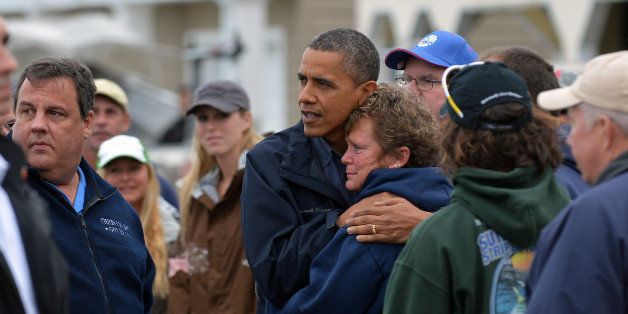 US President Barack Obama comforts Hurricane Sandy victim Dana Vanzant as he visits a neighborhood in Brigantine, New Jersey,