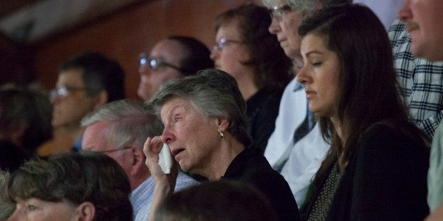 DARRINGTON, WA - APRIL 5: A woman wipes tears from her eyes during a memorial service for Linda McPherson, a beloved member o