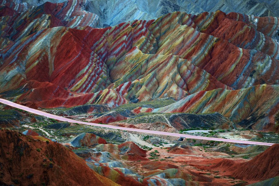 "This mountain range appears to be Dr. Seuss inspired. The trippy landscape (yes, <a href=""https://www.huffpost.com/entry/rain"