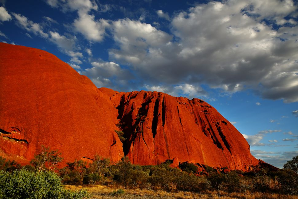 This vibrant and vast sandstone formation, also known as Uluru, is a striking contrast to another one of Australia's natural