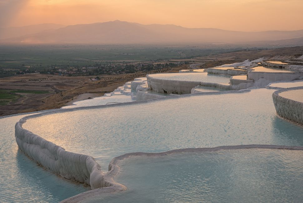 "<a href=""http://whc.unesco.org/en/list/485"" target=""_blank"">Pamukkale translates to ""cotton castle.""</a> The crystal pools ar"