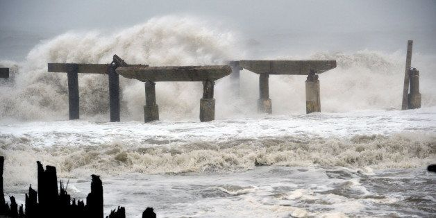 Waves crash against a previously damaged pier before landfall of Hurricane Sandy October 29, 2012 in Atlantic City, New Jerse
