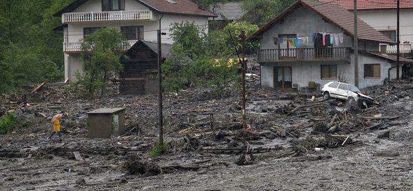 A view of a landslide and floodwaters around houses in the village of Topcic Polje, near the central Bosnian town of Zenica,