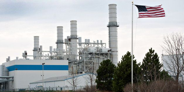 A U.S. flag flies in front of the natural gas fired 1200-megawatt Kendall Energy power plant, owned by Dynegy Inc., in Minook