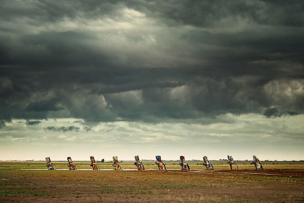 """A storm above the famous <a href=""""http://en.wikipedia.org/wiki/Cadillac_Ranch"""" target=""""_blank"""">Cadillac Ranch</a> art install"""