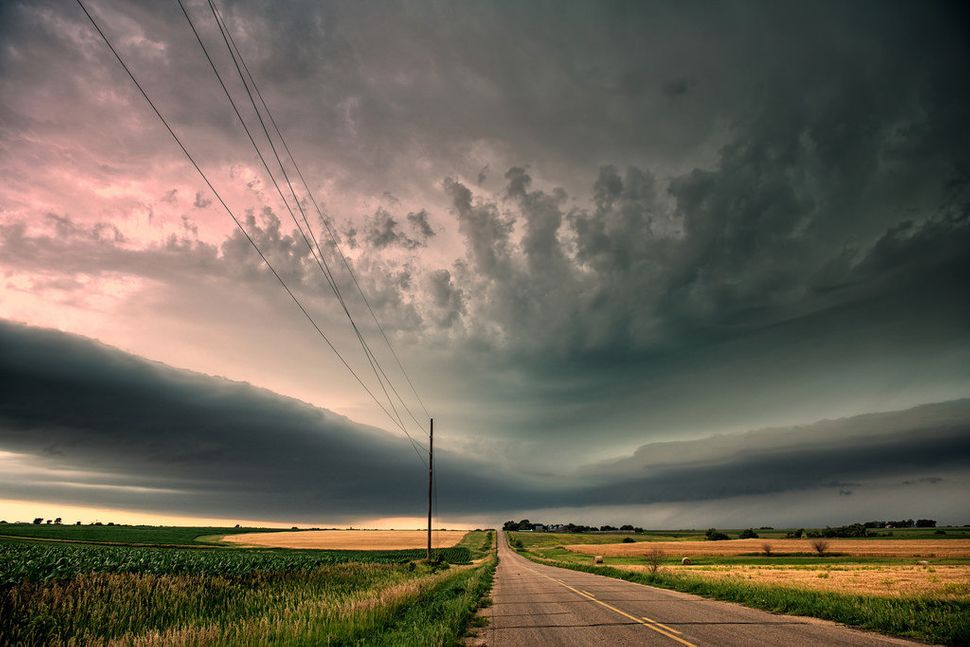 A supercell storms forms above the plains of Kansas.