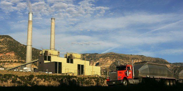 HUNTINGTON, UT - AUGUST 13:  A coal truck drives along Highway 31 near the coal-powered Huntington Canyon Power Plant on the