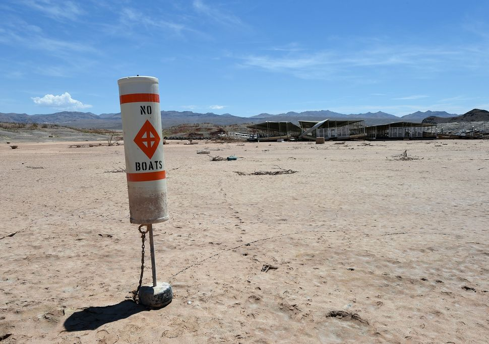 """A buoy warning """"no boats"""" stands on dirt at the abandoned Echo Bay Marina on July 13, 2014 in the Lake Mead National Recreati"""