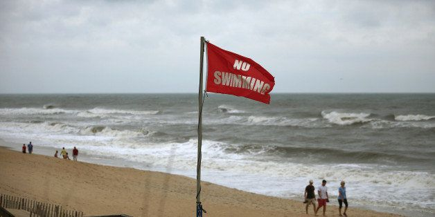 NAGS HEAD, NC - JULY 04:  No swimming flags are posted due to the heavy surf left by Hurricane Arthur, July 4, 2014 in Nags H