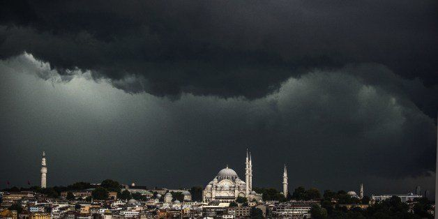 Clouds gather over the Suleymaniye Mosque (R) during a storm on August 7, 2014, in Istanbul. AFP PHOTO/BULENT KILIC        (P