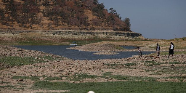 IONE, CA - AUGUST 08:  Visitors walk on what used to be the bottom of the Camanche Reservoir on August 8, 2014 in Ione, Calif