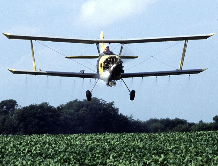 Near Sheldon, Illinois, grower Joe Zumwalt applies a low-insecticide bait that is targeted against western corn rootworms feeding on and ...