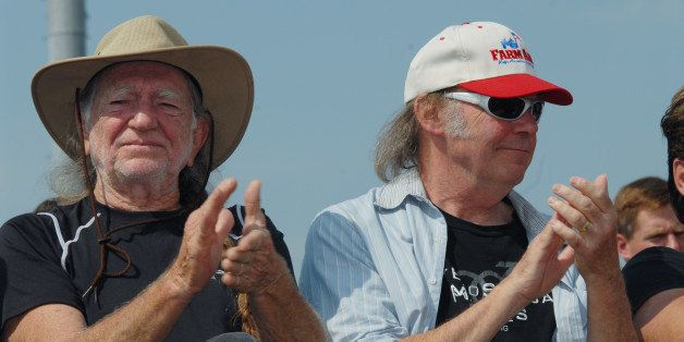 UNITED STATES - SEPTEMBER 09:  FARM AID  Photo of Neil YOUNG and Willie NELSON, With Neil Young (R) at a press conference at