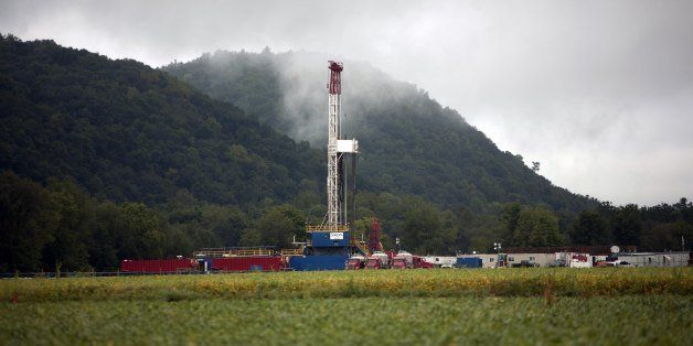 FAIRFIELD TOWNSHIP, PA - SEPTEMBER 8: A soybean field lies in front of a natural gas drilling rig September 8, 2012 in Fairfi