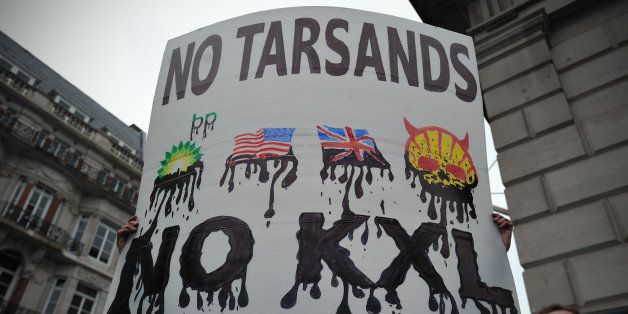 Protesters take part in a rally in central London on April 11, 2013 to demonstrate against the Keystone XL Tar Sands Pipeline