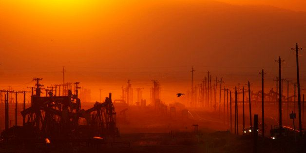 LOST HILLS, CA - MARCH 24:  The sun rises over an oil field over the Monterey Shale formation where gas and oil extraction us